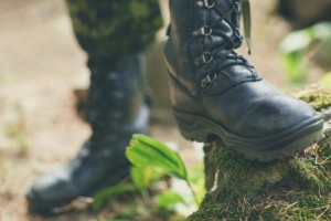 War, hiking, army and people concept - close up of soldier's foot in army boot